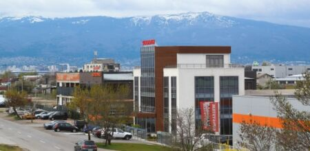 NES Ltd., Kereskedelmi központ